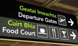 Departure gates sign. Sign showing the direction to the departure gates and the food court in an Irish airport Stock Image