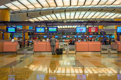 Departure hall at Changi airport with check-in zone Stock Images