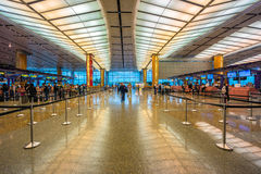 Departure hall at Changi airport with check-in zone Stock Photos