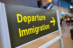 Departure immigration. Signboard in an airport stock photo