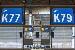 Departure gate information signal at airport terminal. Travel ba Royalty Free Stock Photography