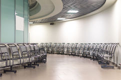 Departure lounge in an airport with chairs. Round galary. Stock Images