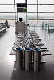 Departure lounge of an airport. With seats, dustbins and windows with view on the apron Stock Image