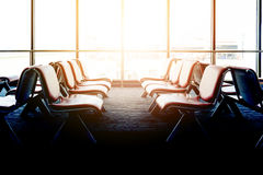 Departure lounge with empty chairs in the terminal of airport Royalty Free Stock Photo