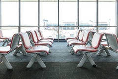 Departure lounge with empty chairs in the terminal of airport Stock Photo