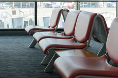 Departure lounge with empty chairs in the terminal of airport Stock Image