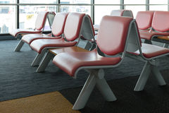 Departure lounge with empty chairs in the terminal of airport Royalty Free Stock Photos