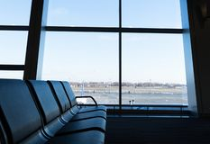 Departure modern lounge at the airport. Blue toned image royalty free stock photos