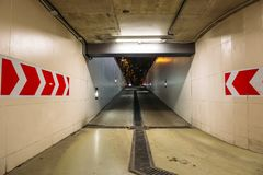 Departure outward from Underground parking or garage, urban tunnel with arrows, city car infrastructure Royalty Free Stock Images