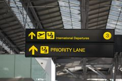 Departure and priority lane board sign at international airport stock image