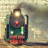 Departure of the retro steam train. Royalty Free Stock Image