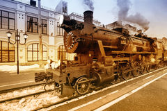 Departure of the retro steam train. Departure of the retro steam train at spring evening time stock photo