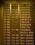 Departure schedule board in airport Stock Photo