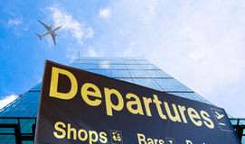 Departure sign and airplane in the sky. Departure sign and airplane in the blue sky Royalty Free Stock Images