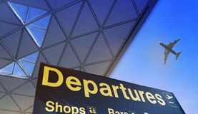 Departure sign and airplane in the sky. Departure sign and airplane in the blue sky Stock Photo