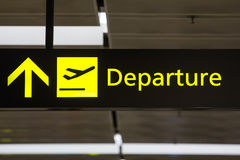 Departure sign in the airport. Close-up Royalty Free Stock Photo