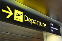 Departure sign hangs at Changi Airport Terminal 1. SINGAPORE- JUN 18, 2017: Departure sign hangs over busy travellers at Changi Airport Terminal 1 departure hall Stock Images