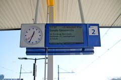 Departure sign on platform with clock with delay information on Voorburg railway station in the Netherlands. Departure sign on platform with clock with delay royalty free stock photography