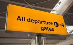 Departure sign, UK. Orange departure sign in a airport, UK Royalty Free Stock Image