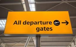 Departure sign, UK. Orange departure sign in airport, UK Stock Photo