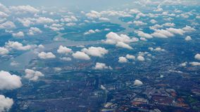 Departure from Singapore. Aerial view Singapore, view fom departing aircraft stock video footage