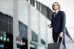 Departure. Successful businessman with luggage, passport and ticket going to departure platform Stock Images