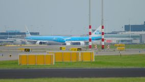 Departure traffic in Shiphol airport. AMSTERDAM, THE NETHERLANDS - JULY 24, 2017: KLM Royal Dutch Airlines Boeing 747 PH-BFC and Boeing 777 taxiing before take stock video