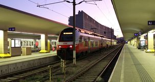 Departure of the train from the city railway station stock footage