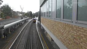 Departure of the train from the station. London. England. United Kingdom. The station of the railway. departure time of the train stock footage