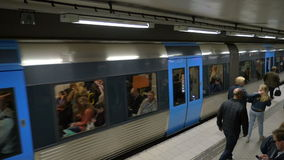 Departure of the Train in Stockholm Metro. STOCKHOLM, SWEDEN - APRIL 26, 2015: High-angle slow motion shot of the departure of metro train. Some people are stock footage