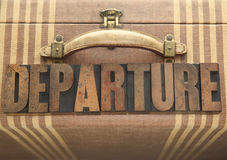 Departure word on old luggage Stock Image