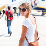 Departure - young woman at an airport Royalty Free Stock Photos