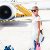 Departure - young woman at an airport Royalty Free Stock Photo