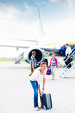 Departure - young woman at an airport Stock Photography