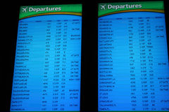 Departures. Departure screen at busy airport depicting business travel Royalty Free Stock Image