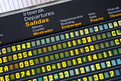 Departures board at airport Stock Photos