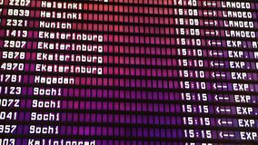 Departures board at the airport. Flight information electronically timetable. Split flap mechanical departures board stock image