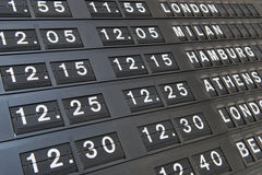 Departures board at an airport terminal Stock Image