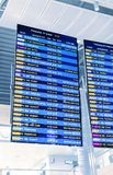 Departures display board at airport terminal showing international destinations flights to some of the world`s most popular citie royalty free stock photography