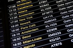 Departures flight information schedule in international airport Stock Images