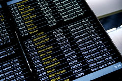 Departures flight information schedule in international airport Stock Photo
