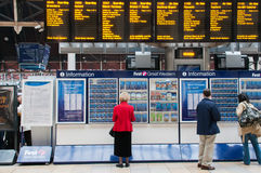 Departures from Paddington. People looking at the departures board at the London Paddington train station Royalty Free Stock Photography