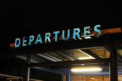 Departures Sign at Night Royalty Free Stock Images