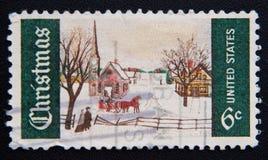 depciting一个多雪的圣诞节场面的美国的邮票,大约1969年 免版税库存图片