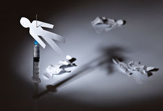 Dependence. The conceptual image on a theme of narcotic dependence, white reflective background Stock Photo