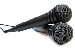 depeszujący karaoke czarny mikrofony dwa Zdjęcia Royalty Free