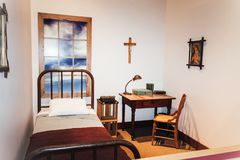 A depiction of the simple bedroom of Father Casey Solanus. Detroit, USA - October 2nd, 2016: A depiction of the simple bedroom of Father Casey Solanus on dsiplay stock image