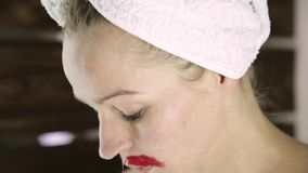 Depilation with hot wax of a mustache in home. Young woman does facial epilation stock footage