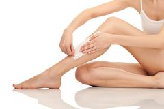 Depilation legs with waxing and tape Stock Photos