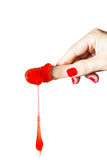 Depilatory Wax dripping. Red wax Depilatory dripping over white background, with a human hand and spatule Stock Photo